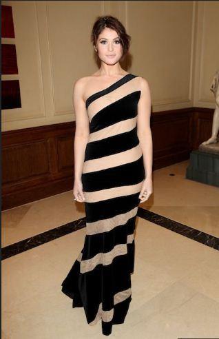 Gemma Arterton wore a Celia Kritharioti asymmetric gown with nude and black chevron stripes.